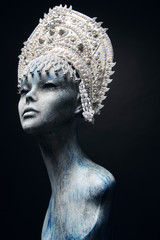 Head of mannequin in creative white metal kokoshnick with pearls