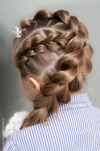 Festive Hairstyle From Braid On A Girl With Long Hair Back View