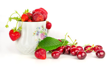 Strawberry and cherry fruits on white background