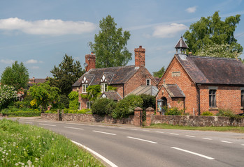 Pretty cottage and church in Burlton Shropshire