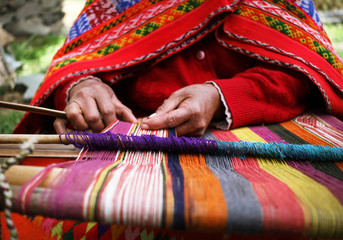 Close up of a woman weaving in Peru