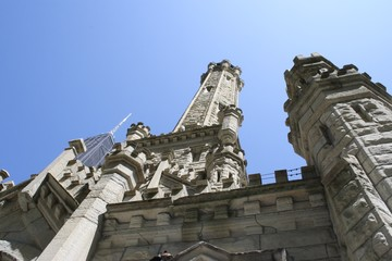 Looking up at white stone cathedral