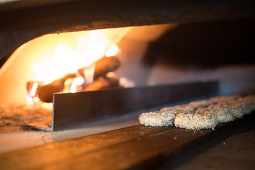 Bagels baking in a wood fired oven