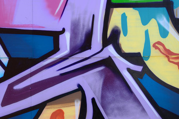 Street art. Abstract background image of a fragment of a colored graffiti painting in cosmic blue...