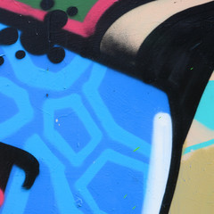 Street art. Abstract background image of a fragment of a colored graffiti painting in blue tones