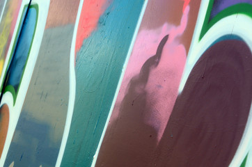 Street art. Abstract background image of a fragment of a colored graffiti painting in fashionable colors