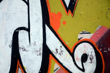 Street art. Abstract background image of a fragment of a colored graffiti painting in white and...