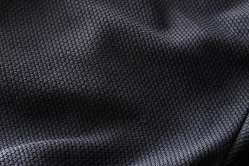Fotobehang Stof Close-up polyester fabric texture of black athletic shirt