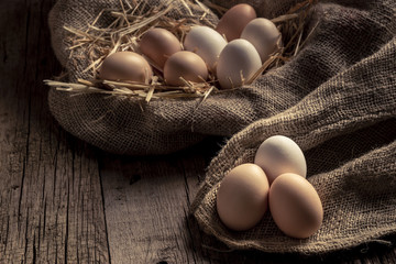 Fresh eggs on wooden dark table