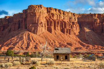 Aluminium Prints Natural Park American Southwest Desert Landscape. Classic eroded Navaho sandstone bluffs and blue skies bring up an image of the old west. This is especially true here in Torrey, Utah, near Capitol Reef Park.