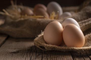 Fresh eggs on wooden dark table