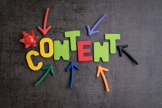 Content is king in brand communication and advertising concept idea, colorful arrows pointing to the word CONTENT at the center with red crown on black cement wall