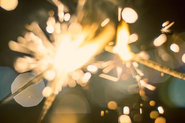 Sparkler Bokeh Colorful sparkler. Night background with a sparkler.
