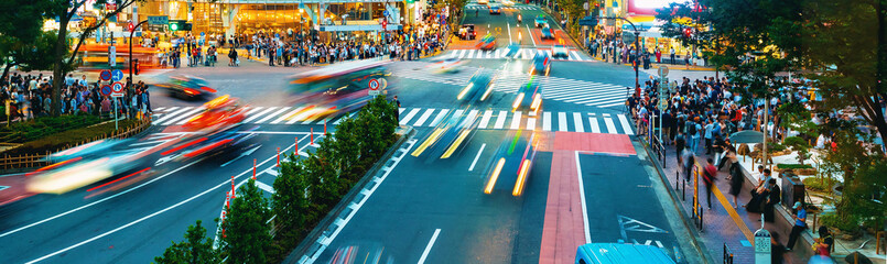 People cross the famous intersection in Shibuya, Tokyo, Japan one of the busiest crosswalks in the world