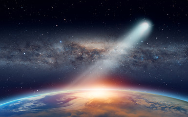 "Bright comet approaching to The Sun in space ""Elements of this image furnished by NASA."""