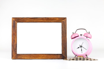 Blank frame, pink alarm clock  on white background