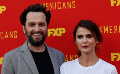 """Cast members Rhys and Russell pose at an event for the finale of the television series """"The Americans"""" in Los Angeles"""