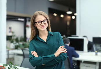 Young woman in modern office. Small business owner