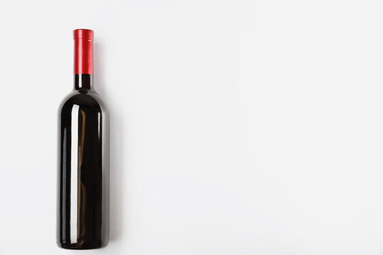 Bottle of delicious wine on white background
