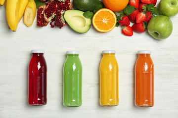 Flat lay composition with tasty juices and ingredients on light background