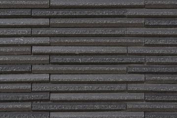 Modern black stone block wall background