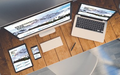 Wall Mural - top view workplace with devices showing responsive design website