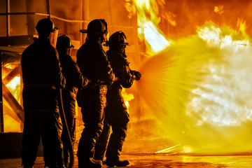JOHANNESBURG, SOUTH AFRICA - MAY, 2018 Firefighters spraying down fire during firefighting training exercise
