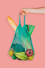 Fashionable and ecological string shopping bag in woman hand