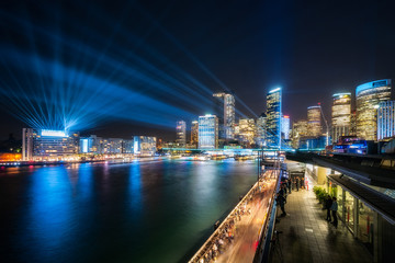 Colorful lights and lasers illuminate Sydney Skyline at Circular Quay for Vivid Festival 2018 in Sydney, Australia.