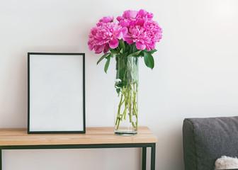 Blank frame mock up in minimalist interior