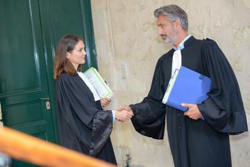 judges shaking hands