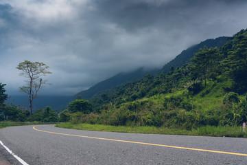 New smooth asphalt road in mountain Bokor National Park. Near Kampot, Cambodia.