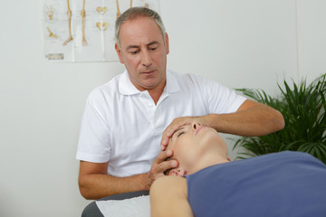 male physio-therapist treating a female patient