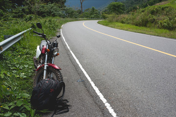 Panoramic view of Bokor Mountain in National Park near Kampot. Motorbike standing at the side of the road.