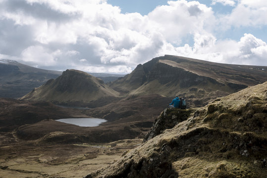 Couple enjoying a break with mountain view in Quiraing, Isle of skye in Scotland
