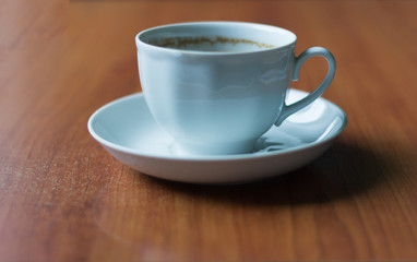 white coffee Cup on the table with traces of foam on the edges