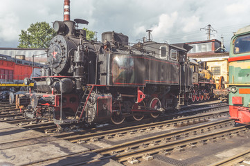 freight old steam locomotive on a Sunny day