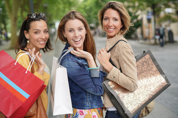 Portrait of cheerful women on shopping day