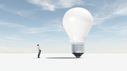 The man looks up towards a big bulb.