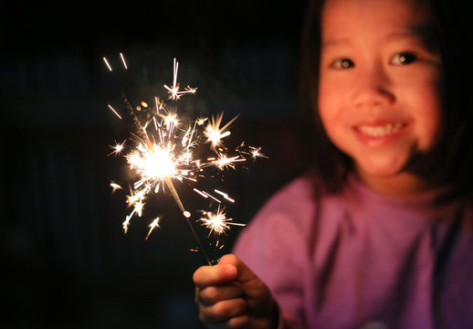 Children enjoy with firecrackers at outdoor.