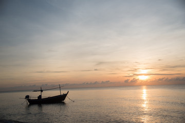 Fishing boat on the beach in the morning with sun rise.