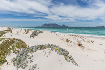 View of Table Mountain from Blouberg in Cape Town with wind surfers