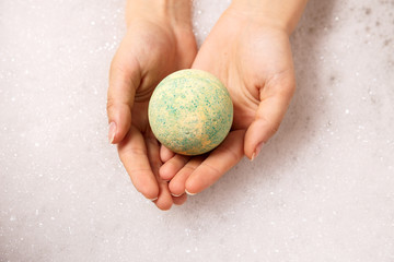 ball of salt dissolves in water. Colored bath bombs