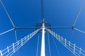 Mast of the ship against the blue sky.