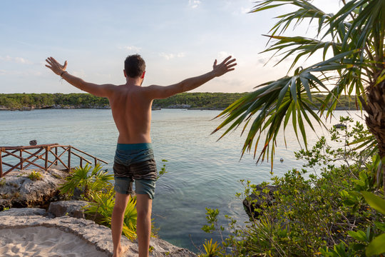 Happy and freedom man on Xel-Ha lagoon reserve in Mexico