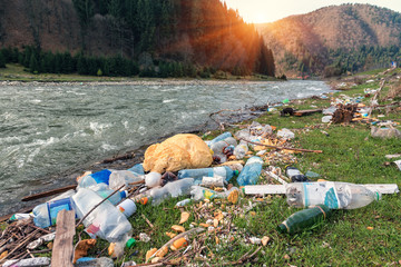 plastic garbage on the river bank