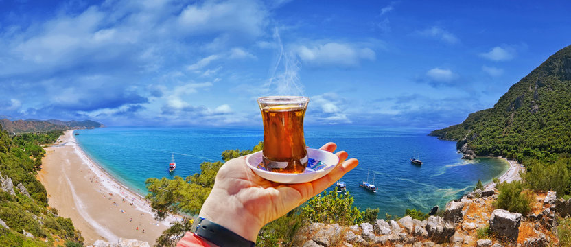 Morning cup of tea with view of colorful panoramic Olympos beach , Cirali, Antalya Province ,Turkey