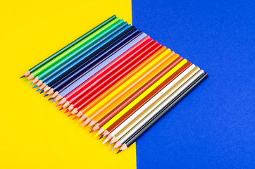 Set of colored pencils for schoolboy on bright background