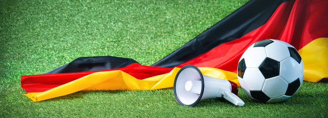 Soccer ball with german flag and megaphone