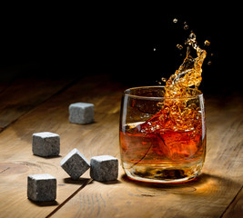 Fototapete - Whiskey and whiskey stones on a wooden table.